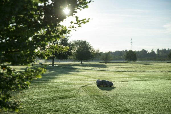 Automower mowing golf course