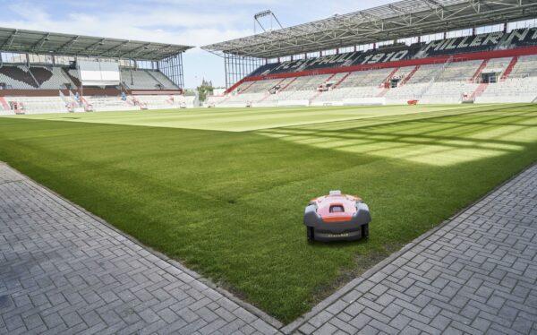 Automower 550 mowing football stadium