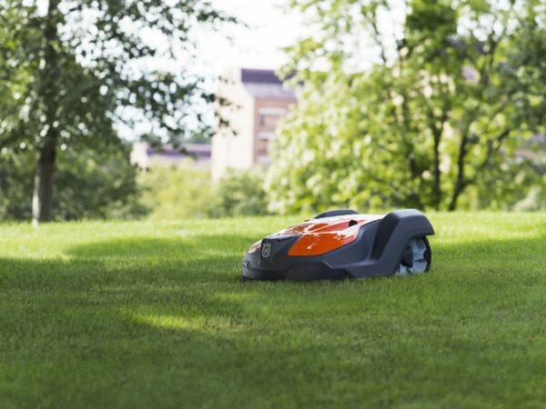 Automower 550 on lawn with trees in background