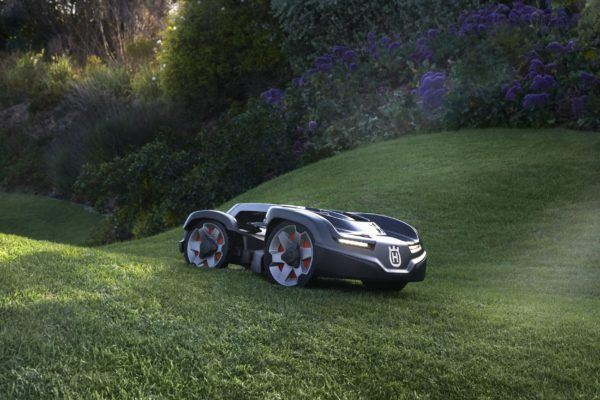 Automower 435X AWD side view mowing hilly garden