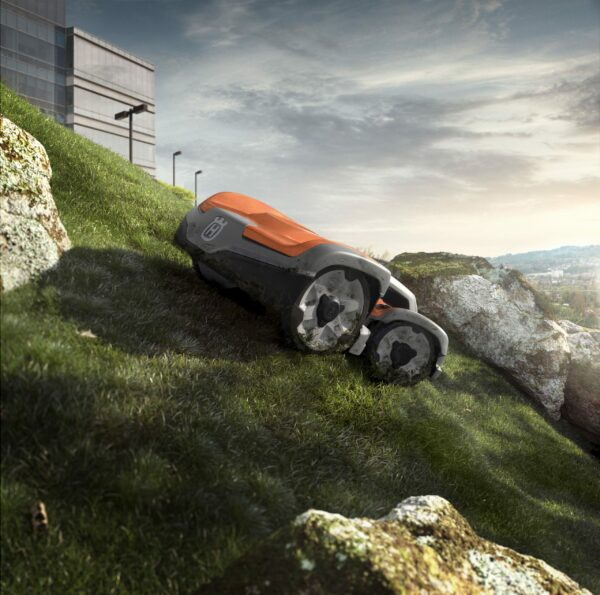 Commercial Automower mowing slope between rocks