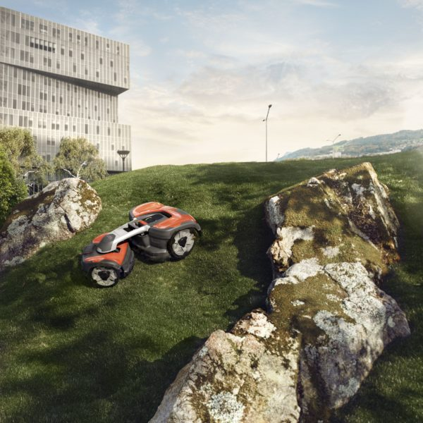 AWD Automower mowing steep slope between rocks